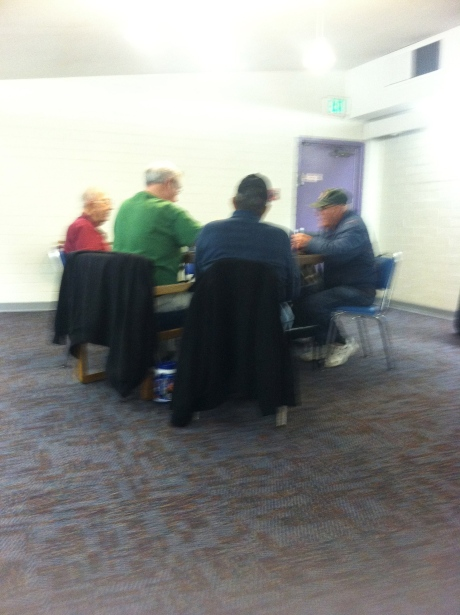 old men playing poker