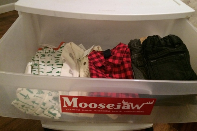drawer of baby clothes